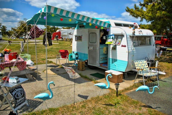 BILL SPINDLER/Courtesy photo Aqua flamingoes match the 1968 Serro Scotty HiLander owned by Heidi Rowell, the event organizer.