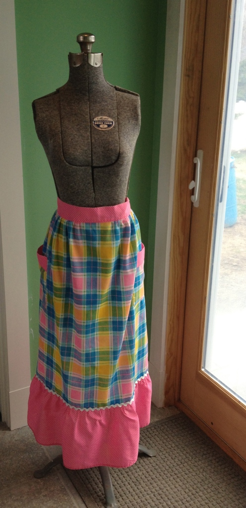 Apron is modeled by a vintage Acme adjustable dress form, size Junior. I haven't been that size since I was eleven.