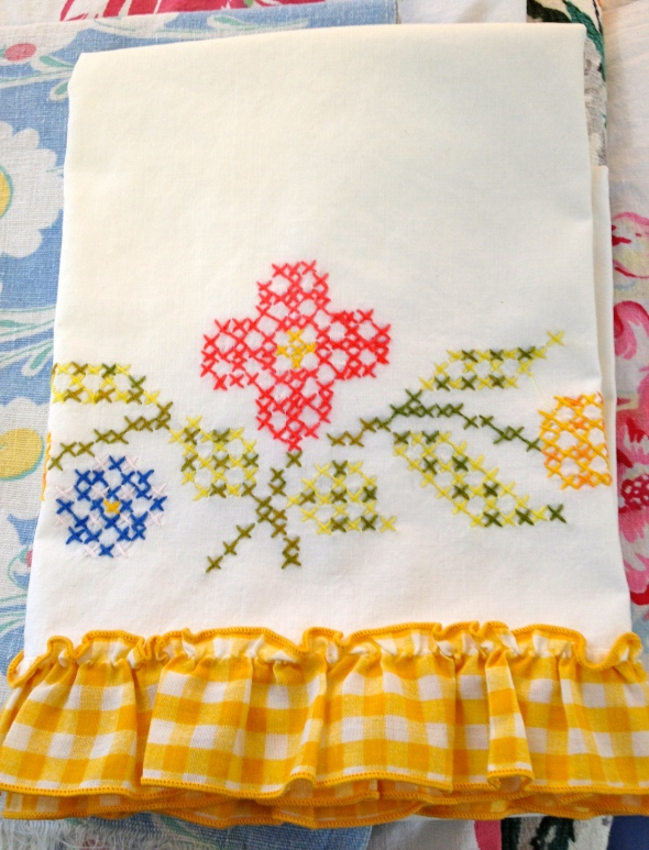 Vintage cross-stitched pillowcase with a yellow gingham ruffle---freshly ironed!