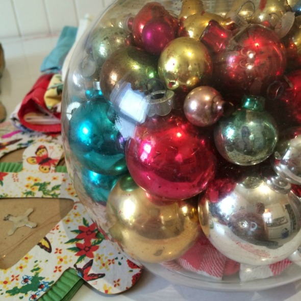 It's silly, but I couldn't resist this fishbowl filled with old Christmas ornaments and the paper party lanterns.