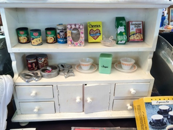 Tiny jadeite on an adorable little cabinet. Don't you love it?