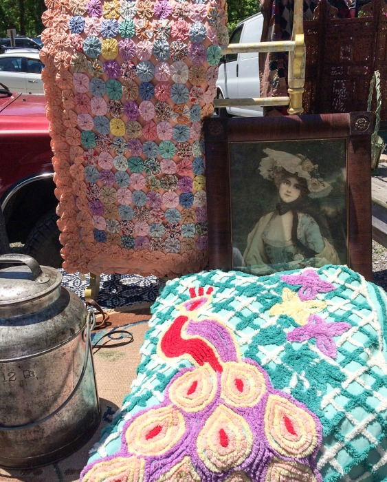 I saw at least half a dozen yo-yo quilts. Never seen a peacock chenille bedspread in person. I was afraid to ask prices.