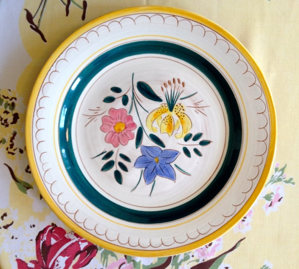 "The pattern is ""Garden Flower."" The glaze is the center of the plate is thinly applied, so you can see the color of the clay peeking through."