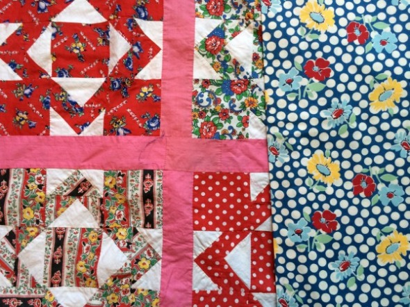 blue dot and flower fabric with vintage quilt