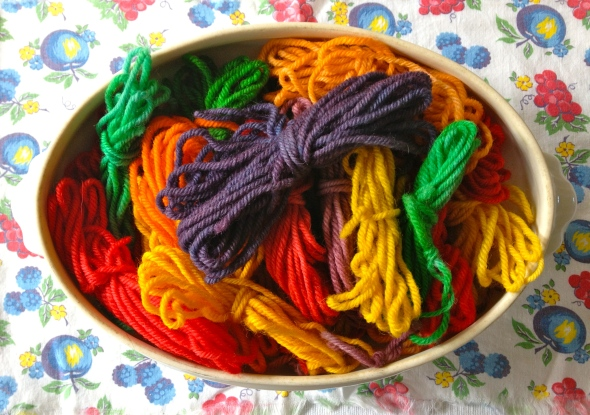 I filled my old ironstone tureen with butterflies of wool yarn in bright Kool Aid colors.