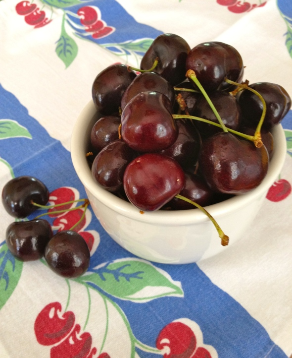 Dark, sweet cherries in a vintage ironstone bowl. The cherry-print napkin isn't vintage---I got it from Crate & Barrel maybe a dozen years ago, back when they offered retro-print linens.