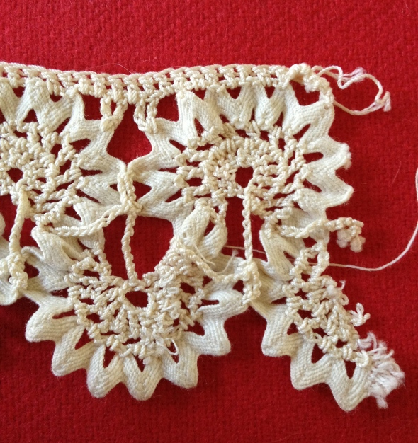 The alternating circular motifs were crocheted, then the straight border was crocheted on top.