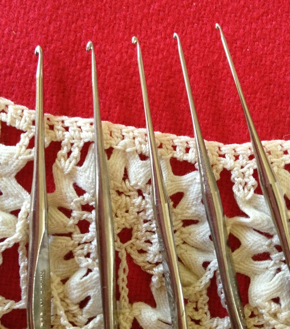 Vintage steel crochet hooks in sizes 8, 9, 11, 12, and 13. My eyes are too old to even think about using these!