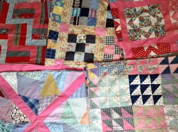 stash of vintage quilt tops