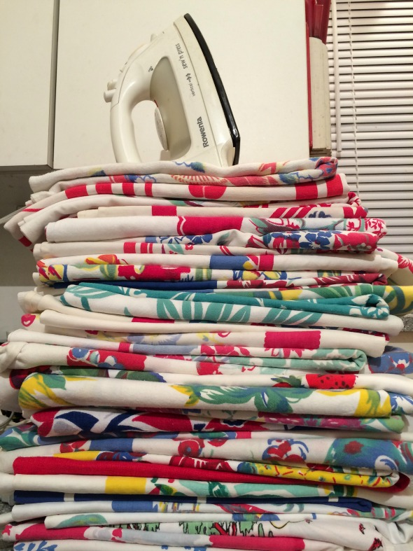 stacking of vintage tablecloths to iron