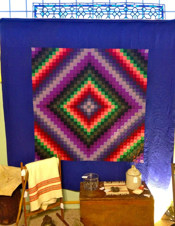That's a battered stained glass window above the quilt, in case you're wondering.