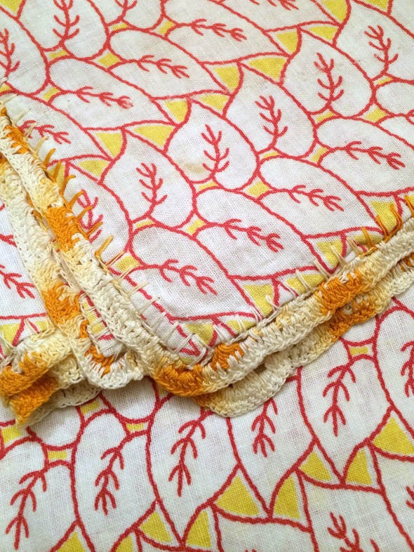yellow crochet trim on a feedsack towel