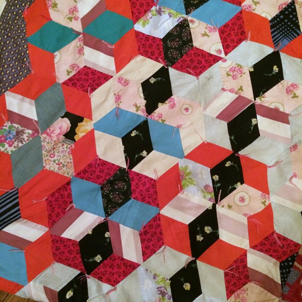 Are they tumbling blocks? Big stars? Pieced hexagons? I love how my brain can't decide.