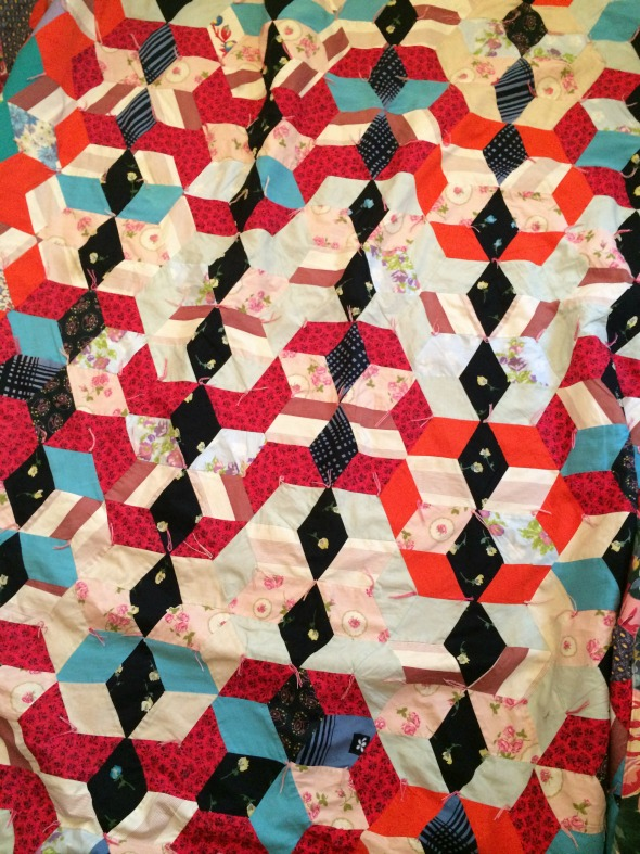 red orange black vintage tumbling blocksquilt