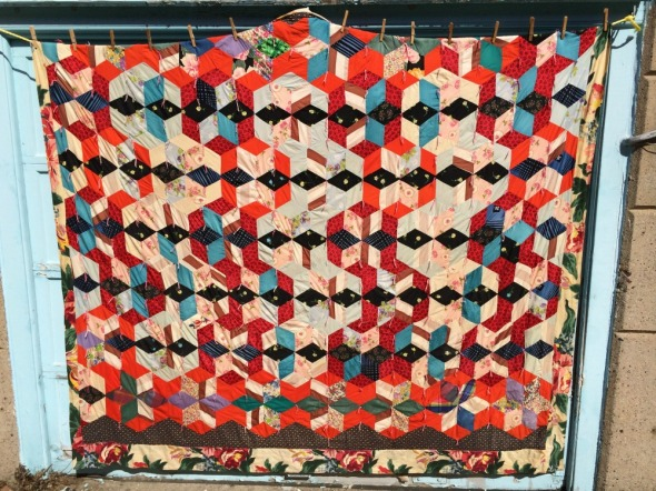 vintage quilt drying on line
